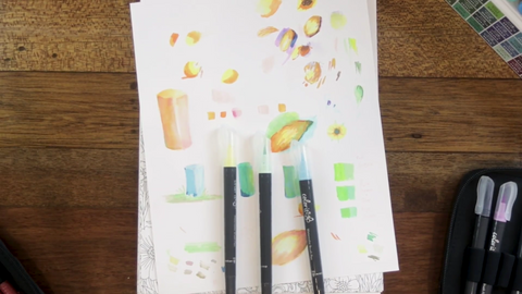 Three watercolor brush pens from ColorIt. The colors are yellow, green, and blue - which Arvin will be using to color in the sunflower.