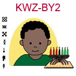 KWZ-BY2 Dark skinned toddler boy with African hair and green shirt next to Kwanzaa Kinara with seven candles