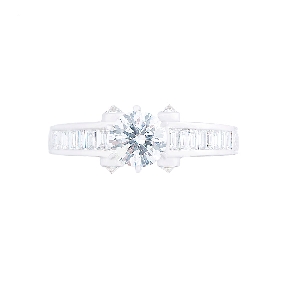 SOLITAIRE DIAMOND RING WITH TAPERED BAGUETTE DIAMONDS