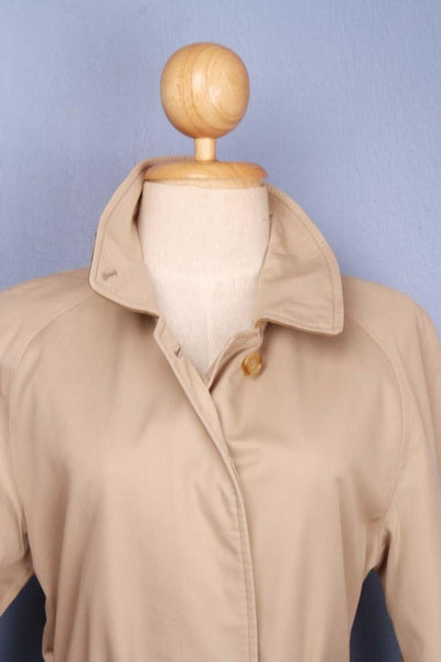 Single beige Burberry trench coat front