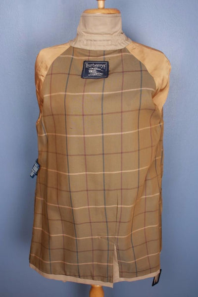 Single beige Burberry trench coat lining