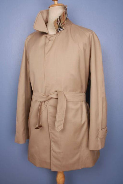 Beige short trench coat from the right