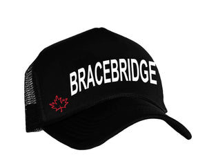 Muskoka cottage country trucker hat with graphic Bracebridge in black, white and red