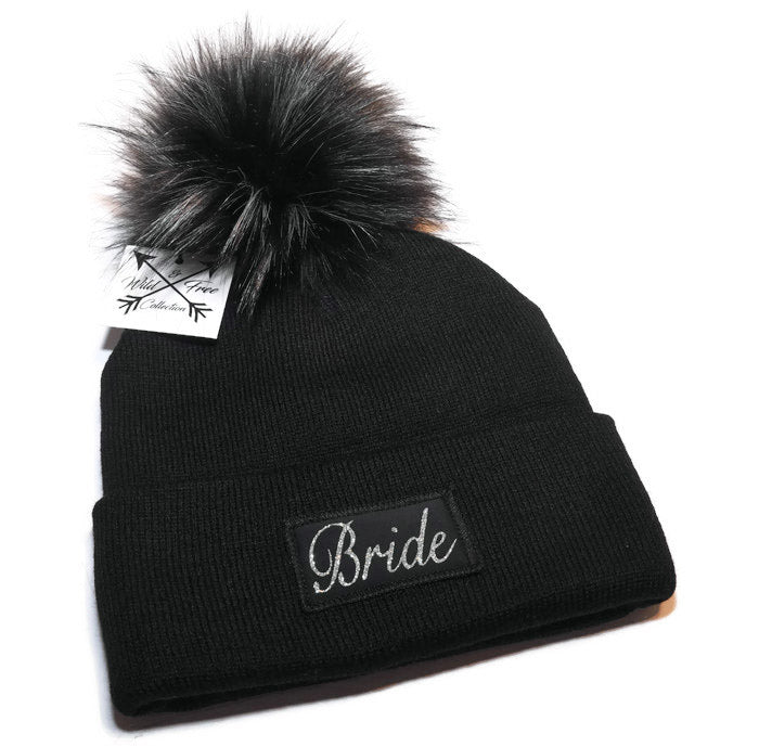 0c777ee05e667 Bride Beanie Toque. Winter hat is black with a sparkly silver graphic patch  and faux ...