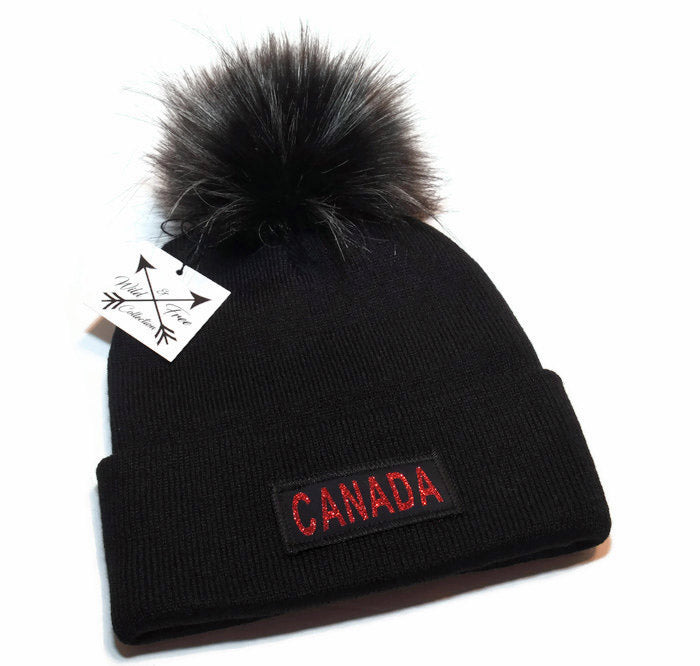 Hat is black with red graphic Canada · Canada Pom Pom Toque in black and  red ... 083f101e4e9