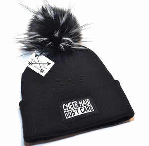 Cheer Hair Don't Care Beanie Hat. Toque is in black and white with faux fur pom om