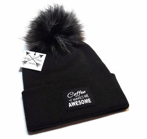 Coffee Makes Me Awesome Winter Beanie Hat. Toque is black and white graphic patch and faux fur pom pom