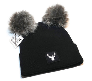 Deer beanie toque. Hat is black and white with two faux fur pom pom ears