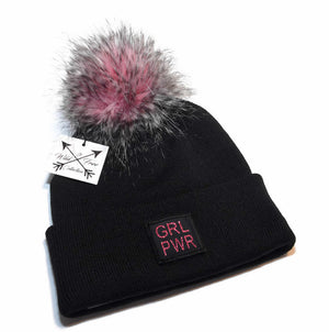 GRL PWR Beanie Toque. Hat is black and blush pink with a large faux fur pink pom pom