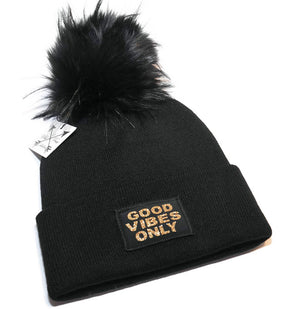 Good Vibes Only Beanie Toque.  Hat is black with a sparkly gold graphic  and faux fur pom pom