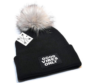 Good Vibes Only Beanie Toque. Black hat with white graphic patch and large faux fur pom pom