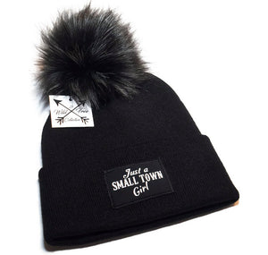 Just A Small Town Girl Beanie Toque in black and white with a large faux fur pom pom