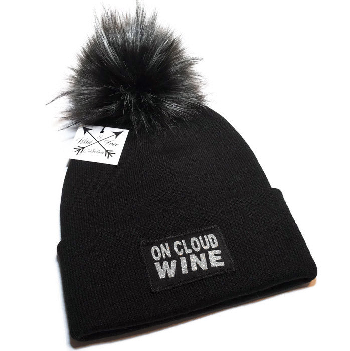 7faf0bdde2746 On Cloud Wine Beanie hat in black and sparkly silver with a faux fur pom  pom ...