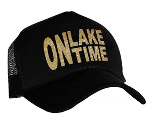 On Lake Time Trucker Hat in black and gold