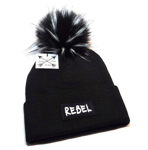Rebel beanie hat in black and white with faux fur pom pom
