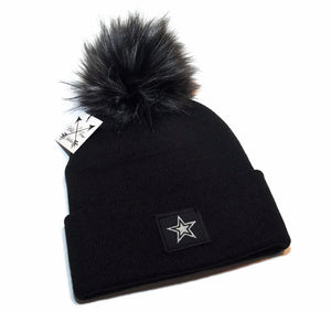 Star beanie toque in black and silver with faux fur pom pom