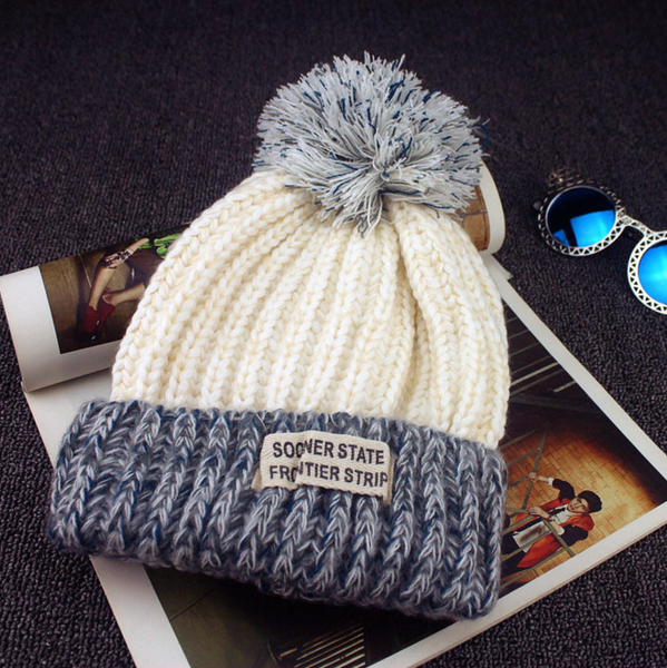 Warm knit hat with pom pom