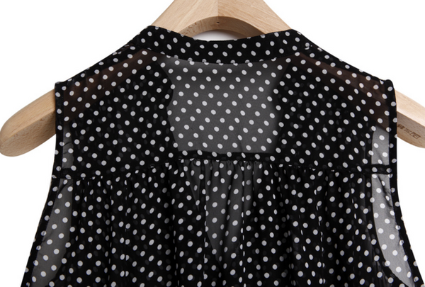 Blouse with polka-dotted