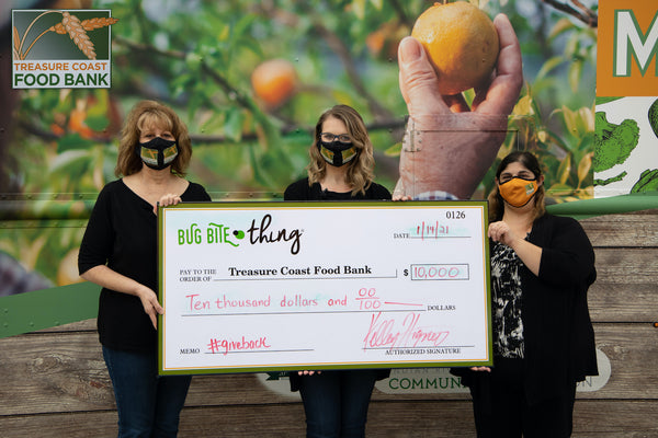 Bug Bite Thing President, Ellen McAlister, and Founder and CEO Kelley Higney, present a check of $10,000 to Treasure Coast Food Bank Chief Resource Officer, Krista Garofalo.