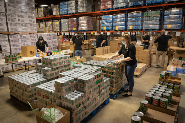 Bug Bite Thing employees build 1,000 food and hygiene boxes for Treasure Coast Food Bank