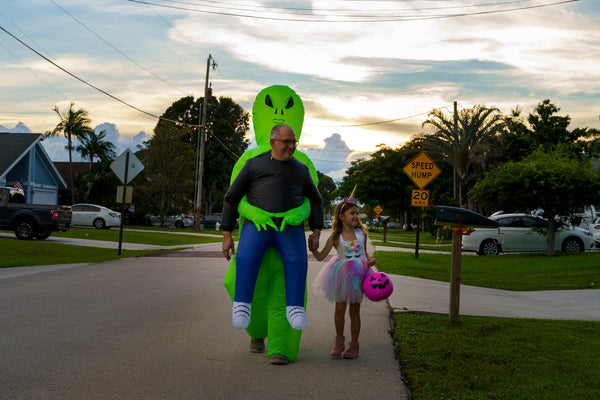 Dad and daughter trick-or-treating