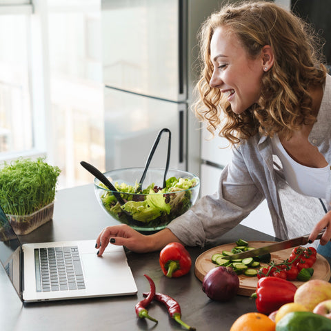 Woman participating in Cozymeal virtual cooking class