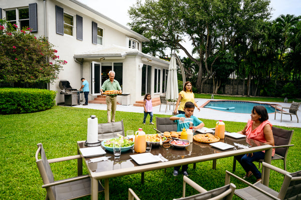 Photo of family having a cookout on the lawn.