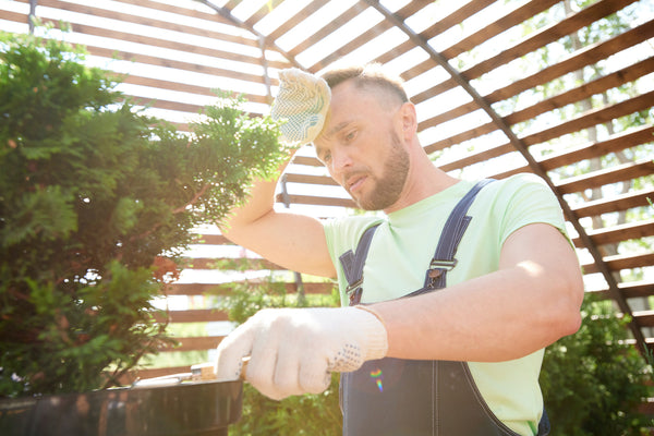 Man gardening in the heat and sweating