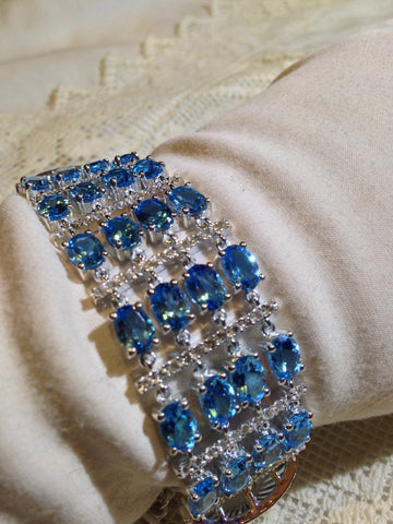 Handmade Blue Topaz Rhodium Finished Sterling Silver Tennis Bracelet