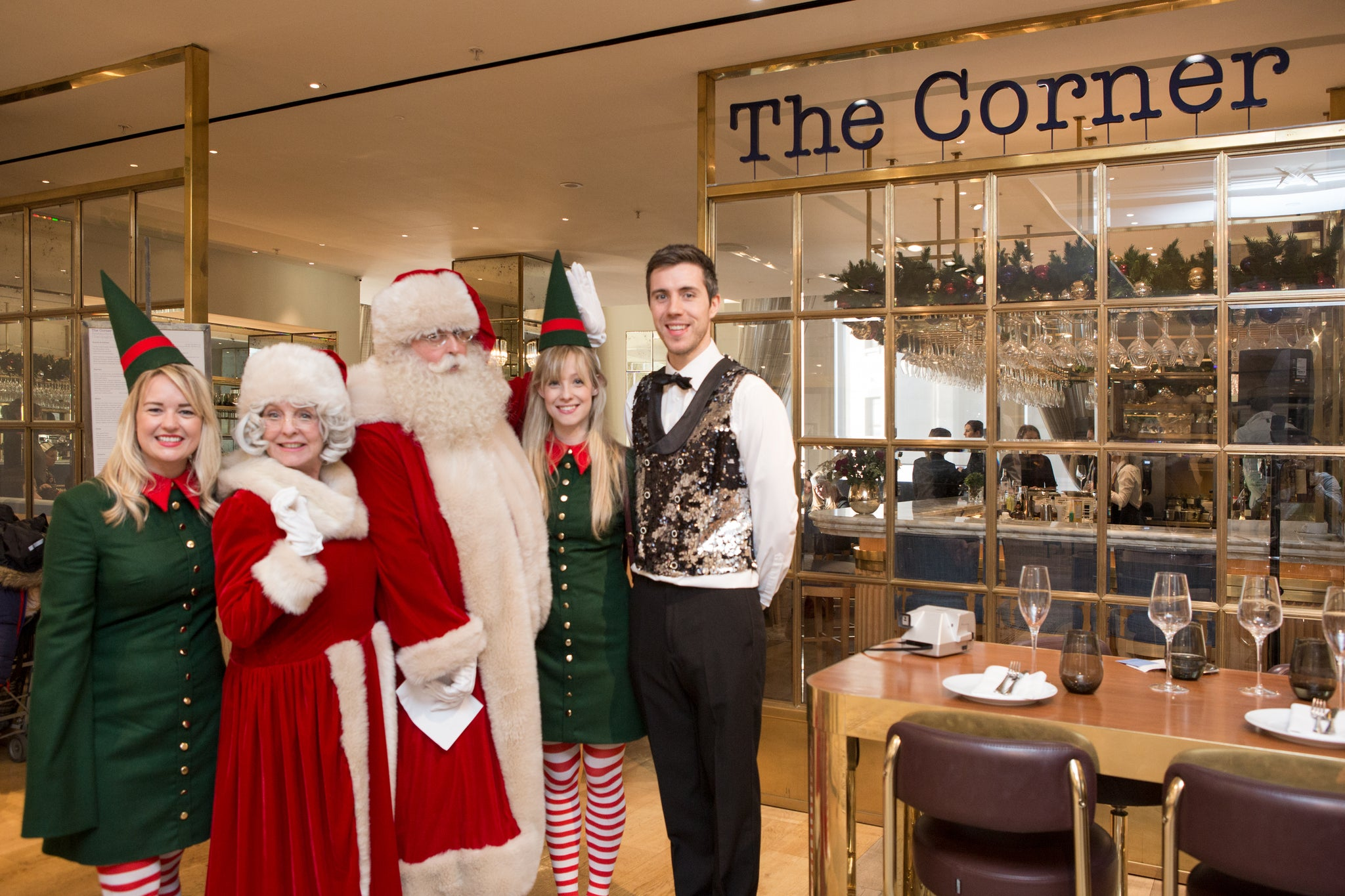 Santa and Mrs Claus in Selfridges with the elves