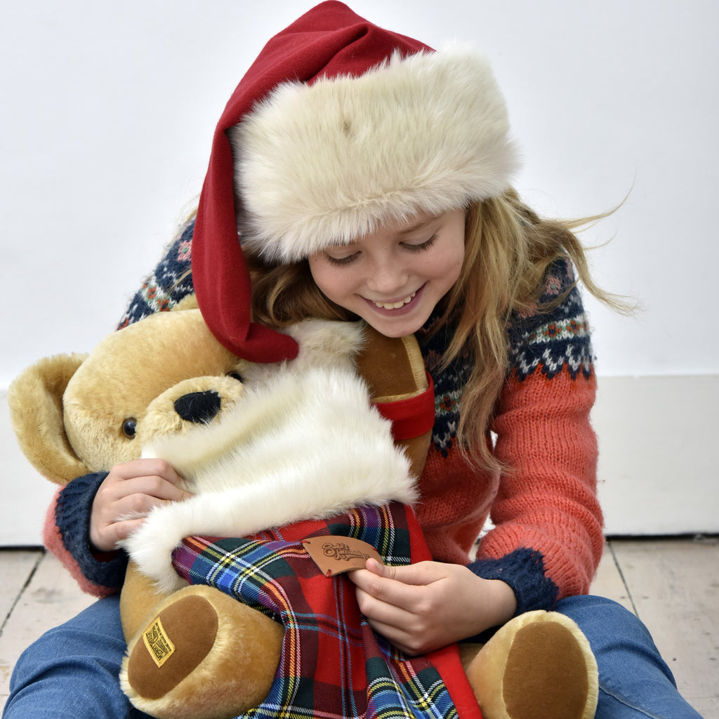 Luxury Santa Christmas hat handmade from the softest merino wool and huggable faux fur, perfect for the Winter weather or Christmas parties