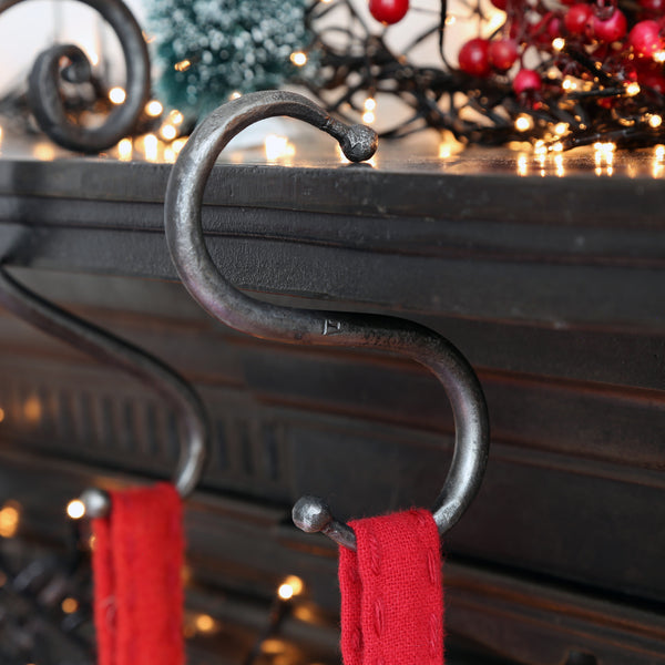 This classic forged iron Hook is ideal to hang your Christmas Stocking.