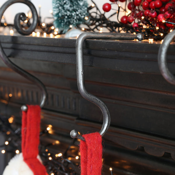Forged Iron Mantel hook Christmas Stocking Hook hanging on a fireplace