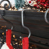 Handmade Forged Iron Christmas Stocking hook suitable for hanging on a fireplace or mantlepiece