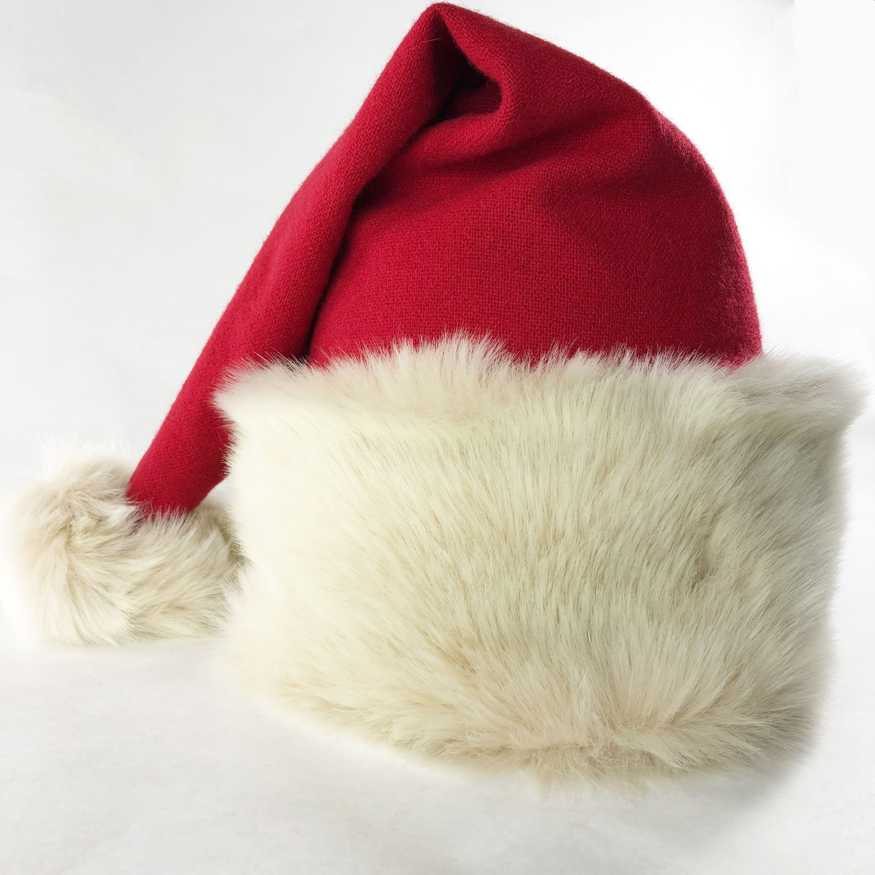 ed7bfa65c57ff ... Luxury Santa hat hand-crafted from with ivory faux fur and red merino  wool in ...
