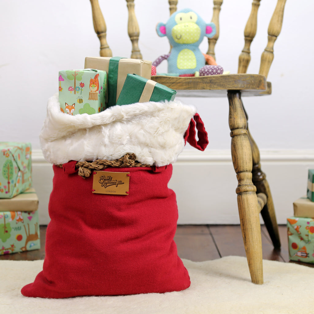Large Santa sack with luxury faux fur trim filled with presents