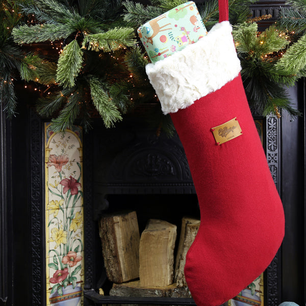 Big Christmas stocking hanging on the fireplace filled with present