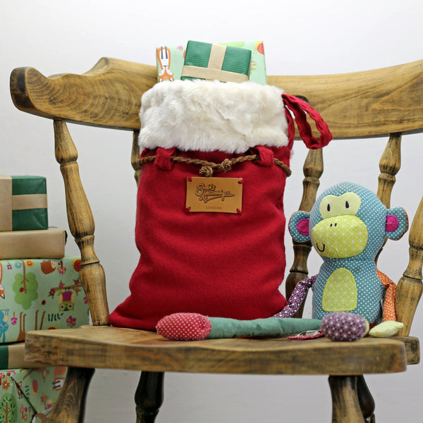 Medium size Christmas sack filled with presents