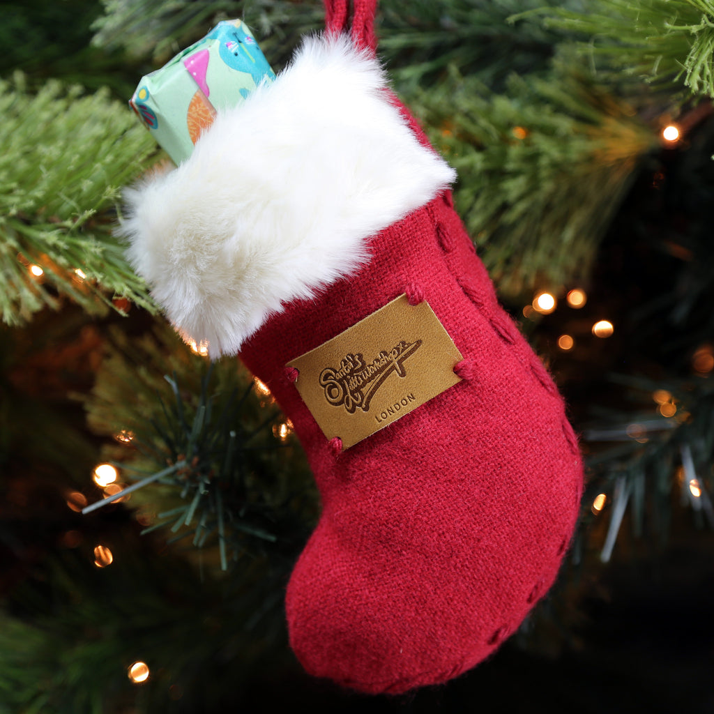 The Mini Stocking from red wool and white faux fur handmade in London by Santa's Little Workshop
