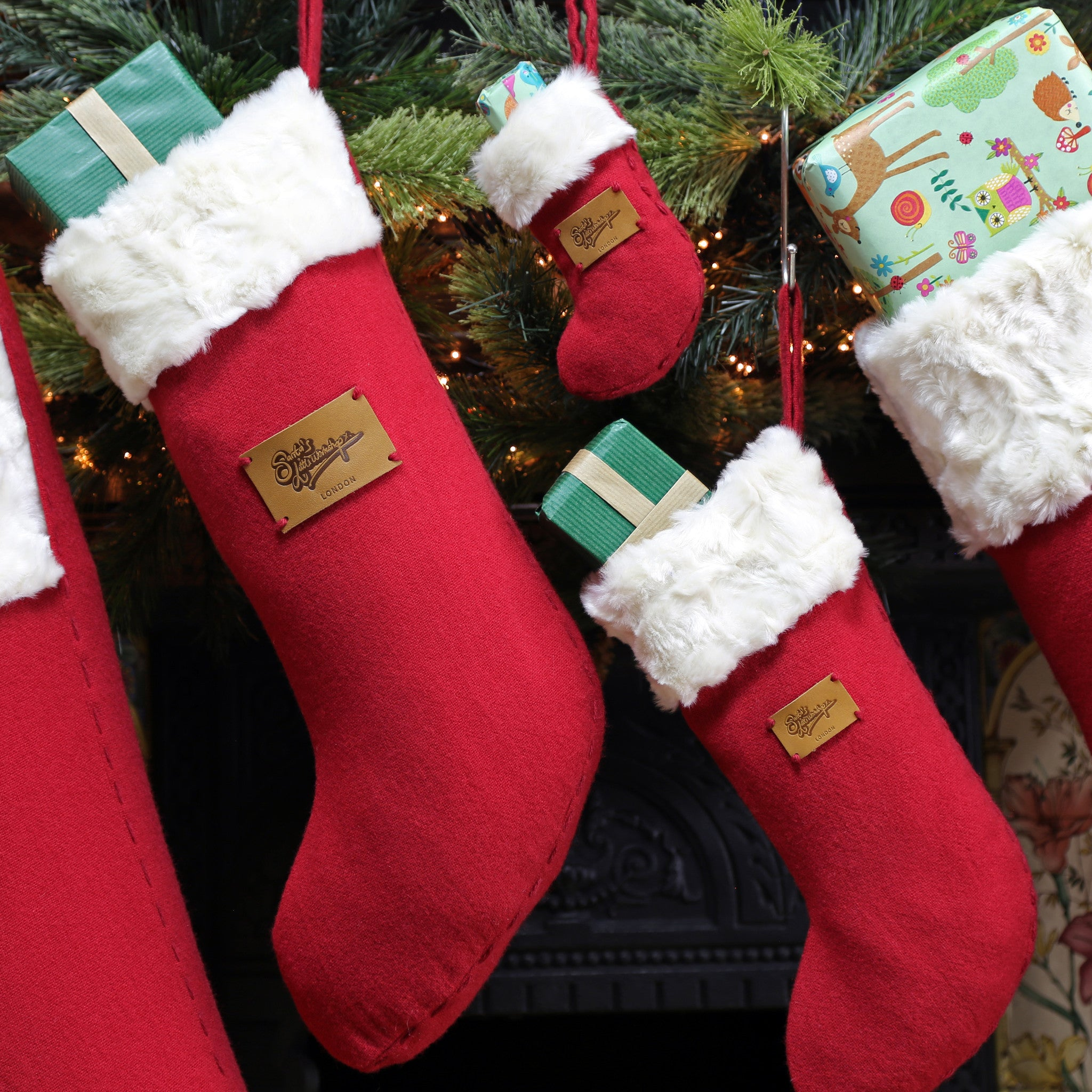 set of 5 christmas stockings u2013 santa u0027s little workshop