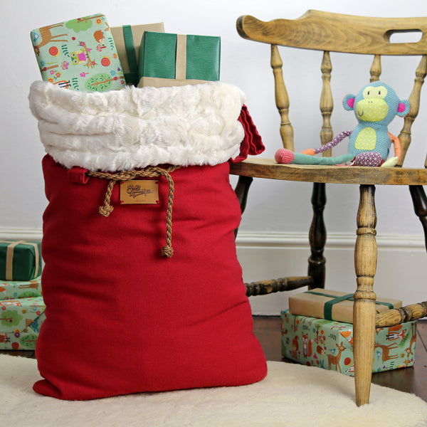 This large Santa sack is filled with presents to the top