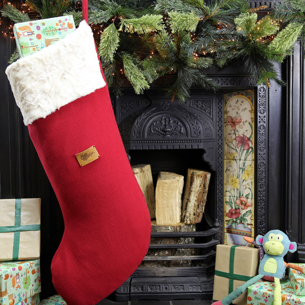 The biggest Christmas stocking hanging on the fireplace