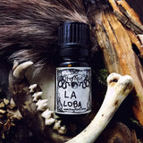 LA LOBA-(Charred Woods, Moss Covered Bones, Black Tea, Warm Spices, Amber Resin)