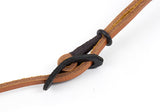 Adjustable neck strap. Dark brown leather buckle on light brown adjustable neck strap.