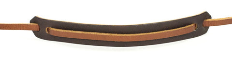 Dark brown neck pad. Light brown neck strap.