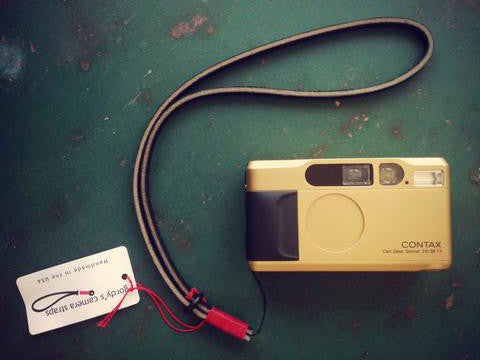 Contax camera neck strap. Single attach point string. Dark brown leather, red wrap.