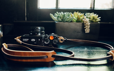 Fujifilm X100f dark brown leather adjustable neck strap with light brown pad.