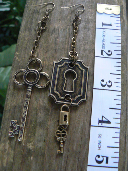 steampunk lock and key earrings dangling keyhole keys and padlock in steampunk fantasy goth boho and hippie style