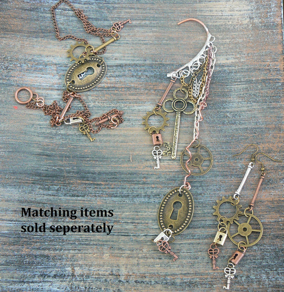 steampunk earrings dangling gears keys and padlocks in steampunk fantasy goth boho and hippie style