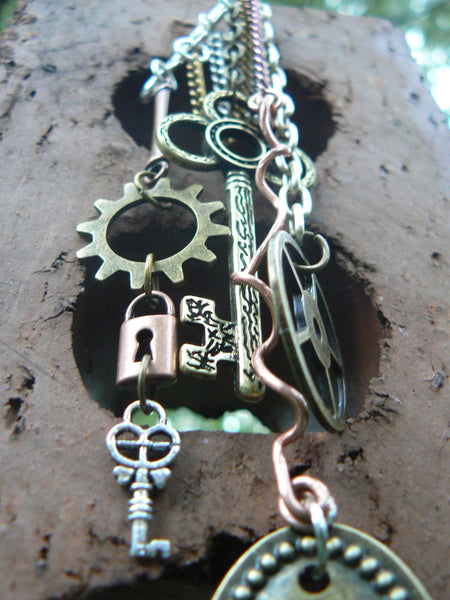 steampunk fantasy ear cuff wrap copper mixed metals keys lock charms in gypsy boho hippie gothic and fantasy style